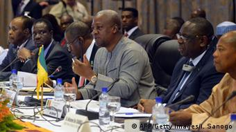 Mahama (in gray, gesturing) voiced confidence in a swift transition