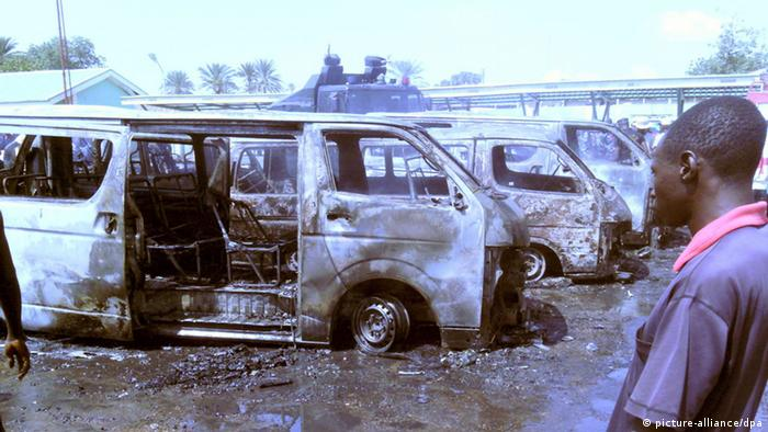 Burned-out vans on a parking lot after a bombing. Photo: EPA/STR