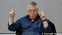 German singer-songwriter and former GDR dissident Wolf Biermann gestures during a session of the lower house of parliament Bundestag to commemorate the 25th anniversary of the fall of the Berlin Wall in Berlin, November 7, 2014. REUTERS/Fabrizio Bensch (GERMANY - Tags: POLITICS)
