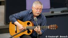 German singer-songwriter and former GDR dissident Wolf Biermann performs during a session of the lower house of parliament Bundestag to commemorate the 25th anniversary of the fall of the Berlin Wall in Berlin, November 7, 2014. REUTERS/Fabrizio Bensch (GERMANY - Tags: POLITICS)