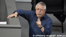 Bildunterschrift:German singer and songwriter and former GDR dissident Wolf Biermann speaks after performing at the German Lower House of Parliament (Bundestag) during a commemoration event of the 25th anniversary of the fall of the Berlin Wall in Berlin on November 7, 2014. Biermann, who was kicked out of East Germany in 1976 for his critical songs, performs in the Bundestag lower house of parliament, in a tribute to those who resisted the regime.AFP PHOTO / TOBIAS SCHWARZ (Photo credit should read TOBIAS SCHWARZ/AFP/Getty Images)
