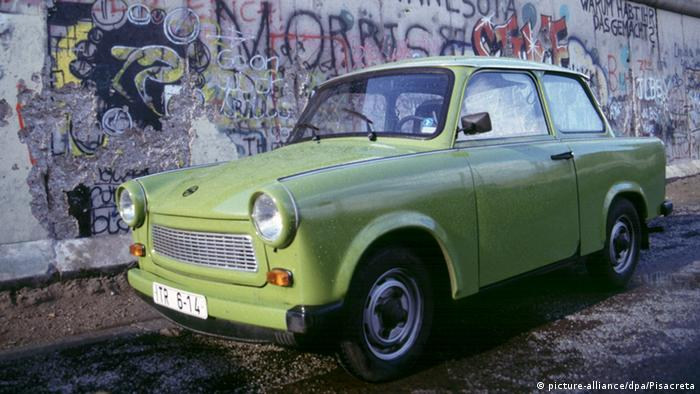 A trabant in front of the Berlin Wall