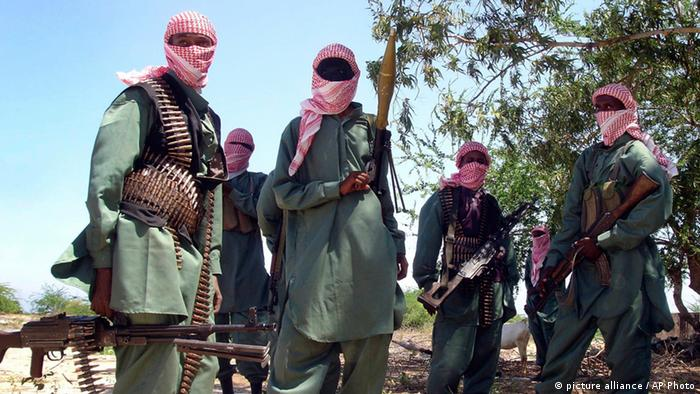 Al-Shabab fighters wearing red-and-white headcloths AP Photo/File