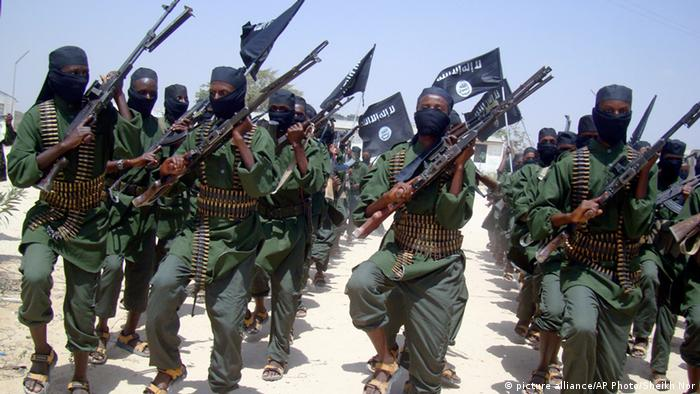 Dozens of Al-Shabab fighters are marching and brandishing weapons. Photo: AP Photo/Mohamed Sheikh Nor, File