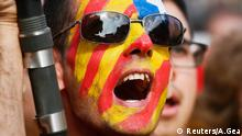 A man with his face painted in the colours of the Estelada, or Catalan separatist flag, takes part in a Catalan pro-independence demonstration in Barcelona October 19, 2014. The wealthy northeastern region of Catalonia last month dropped plans for a non-binding referendum on independence from Spain on Nov. 9 after a court declared such a vote against the constitution and had instead planned to hold a consultation of citizens on the same day. Although Spanish Prime Minister Mariano Rajoy and politicians in Catalonia have called for dialogue over the region's status after the initial referendum plans were abandoned, tensions are still simmering before the Nov. 9 alternative vote. Picture taken October 19, 2014. REUTERS/Albert Gea (SPAIN) - Tags: POLITICS CIVIL UNREST) ATTENTION EDITORS: PICTURE 08 OF 25 FOR WIDER IMAGE PACKAGE 'CATALONIA - THE CONSULTATION OF CITIZENS' TO FIND ALL IMAGES SEARCH 'CITIZENS'