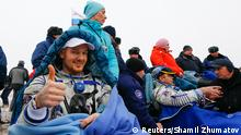The International Space Station (ISS) crew member Alexander Gerst of Germany (L) gestures next to Maxim Surayev of Russia after landing in a remote area near the town of Arkalyk in northern Kazakhstan, November 10, 2014. REUTERS/Shamil Zhumatov (KAZAKHSTAN - Tags: SCIENCE TECHNOLOGY)