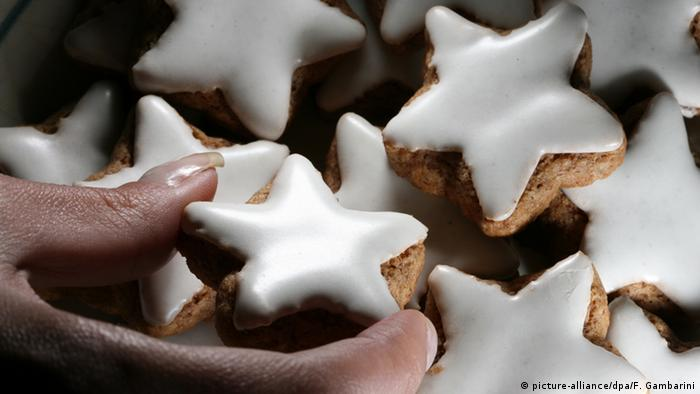 Star shaped cinnamon biscuits with white icing
