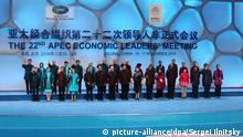 epa04483895 Leaders and their spouses of member countries of Asia-Pacific Economic Cooperation (APEC) pose for a family photo at the Water Cube or National Aquatic Center before a welcome banquet in Beijing, China, 10 November 2014. The Asia-Pacific Economic Cooperation (APEC) 2014 Summit and related meetings will be held in Beijing from 05 to 11 November, gathering leaders of 21 member economies. (Front L-R) Taiwanese Representative Vincent Siew, Mexican President's wife Angelica Rivera and President Enrique Pena Nieto, Chilean President Michelle Bachelet, Sultan of Brunei Hassanal Bolkiah, Philippine President Benigno Aquino III, Russian President Vladimir Putin, Chinese President Xi Jinping and his wife Peng Liyuan, Indonesian President Joko Widodo and wife Iriana, US President Barack Obama, South Korean President Park Geun-Hye, Peruvian President Ollanta Humala, Thai Prime Minister Prayut Chan-o-cha and wife Naraporn, (back L-R) Hong Kong 's Chief Executive Leung Chun-ying, New Zealand Prime Minister's wife Bronagh Key and Prime Minister John Key, Japanese Prime Minister's wife Akie and Prime Minister Shinzo Abe, Canadian Prime Minister's wife Laureen and Prime Minister Stephen Harper, Australian Prime Minister Tony Abbott, Malaysian Prime Minister Najib Razak and wife Rosmah-Mansor, Papua New Guinea Prime Minister Peter O_Neill and wife Lynda May Babao, Singapore Prime Minister Lee Hsien Loong and wife Ho Ching, Vietnam's President Truong Tan Sang,and wife Mai Thi Hanh. EPA/SERGEI ILNITSKY