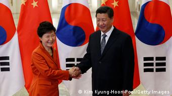 China's President Xi Jinping (R) shakes hands with South Korea's President Park Geun-hye in front of Chinese and South Korean national flags during a meeting at the Great Hall of the People, on the sidelines of the Asia Pacific Economic Cooperation (APEC) meetings, November 10, 2014 in Beijing, China (Photo: Kim Kyung-Hoon-Pool/Getty Images)