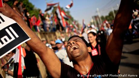 An opponent of Egypt's Islamist President Mohammed Morsi chants slogans during a protest outside the presidential palace, in Cairo, Egypt