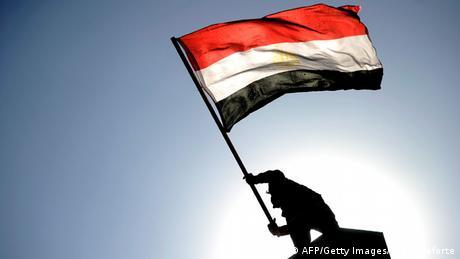 An Egyptian protester waving the national flag