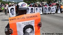 Demonstrators carry pictures of the 43 missing students from the Ayotzinapa Teacher Training College Raul Isidro Burgos, during a march in Acapulco October 31, 2014. The students disappeared in Iguala on September 26 after they clashed with police and masked men. Security forces have combed the area around Iguala in search of the students, whose disappearance has sparked massive protest marches in Mexico and which has become arguably the sternest challenge yet to face Mexico's President Enrique Pena Nieto. The placard reads, Alive they took them. Missing student from Ayotzinapa, Guerrero. REUTERS/Claudio Vargas (MEXICO - Tags: POLITICS CIVIL UNREST CRIME LAW)