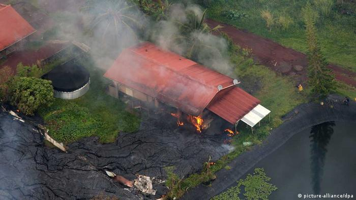 Lava from Kilauea starting to consume the house in Pahoa, Hawaii.
