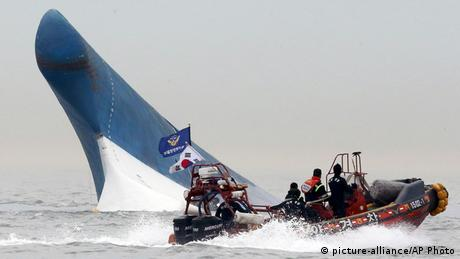 A small motor boat searches for victims of the Sewol accident