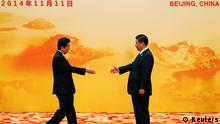 Japan's Prime Minister Shinzo Abe (L) shakes hands with China's President Xi Jinping during a welcoming ceremony of Asia Pacific Economic Cooperation (APEC) forum, inside the International Convention Center at Yanqi Lake, in Beijing, November 11, 2014. REUTERS/Kim Kyung-Hoon (CHINA - Tags: POLITICS BUSINESS)