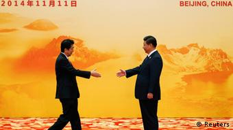 Japan's Prime Minister Shinzo Abe (L) shakes hands with China's President Xi Jinping during a welcoming ceremony of Asia Pacific Economic Cooperation (APEC) forum, inside the International Convention Center at Yanqi Lake, in Beijing, November 11, 2014 (Photo: REUTERS/Kim Kyung-Hoon)