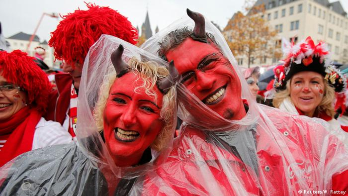 Two carnival revellers dressed as devils