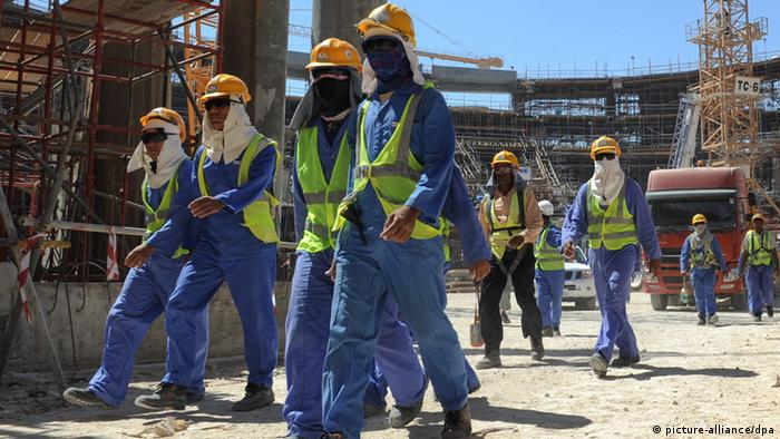 Construction workers leave a building site