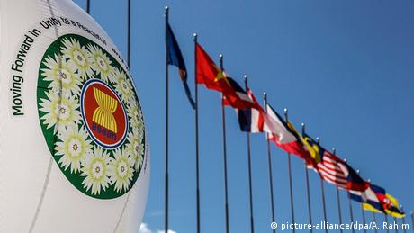 The ASEAN logo stands next to ASEAN members and dialogue partners flags