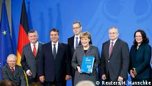 German Chancellor Angela Merkel poses with members of the German economic expert advisory board (SVR) after they presented their 2014/2015 report at the Chancellery in Berlin November 12, 2014. Germany's panel of economic advisors, also known as 'the five wise men' released its annual report on economic development on Wednesday. REUTERS/Hannibal Hanschke (GERMANY - Tags: POLITICS)