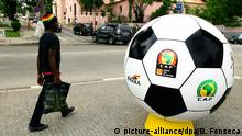 A man walks near an advertising ball model for the African soccer Championship CAN 2010, organized by the Africa Cup of Africa (CAF) that will take place in Angola, Luanda, 08 January 2010.The 27th edition of Africa Cup of Nations, also known as the Orange Africa Cup of Nations, equivalent to the European soccer championships will take place in Luanda from 10 - 30 January 2010. EPA/BRUNO FONSECA