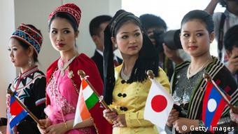 Women dressed in traditional costume greet the heads of state on the second day of the ASEAN summit on November 13, 2014 in Naypyidaw, Myanmar (Photo: Paula Bronstein/Getty Images)