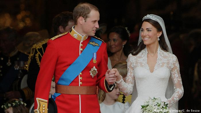 Britain's Prince William and his wife Kate, Duchess of Cambridge, look at each other as they come out of Westminster Abbey following their wedding ceremony, in London, on April 29, 2011 (Photo: AFP/Getty Images/C. de Souza)