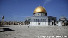 A tourist poses for a picture in front of the Dome of the Rock at the Al-Aqsa mosque compound in the Old City of Jerusalem on November 11, 2014. Recent unrest between Israelis and Palestinians has been fueled by religious tensions at the flashpoint Al-Aqsa mosque compound, as well as by moves to expand settler presence in the occupied eastern sector of the holy city. AFP PHOTO / THOMAS COEX (Photo credit should read THOMAS COEX/AFP/Getty Images)
