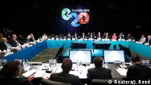 Australian Prime Minister Tony Abbott (Rear, C) addresses the B20 meeting before the G20 leaders summit in Brisbane, November 14, 2014. The B20 meeting engages governments of behalf of the international business community. Leaders of the top 20 industrialized nations will gather in Brisbane November 15-16 for their annual G20 summit. REUTERS/Jason Reed (AUSTRALIA - Tags: POLITICS BUSINESS)