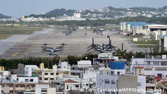 A multi-mission tiltrotor Osprey aircraft at the US Marine's Camp Futenma in a crowded urban area of Ginowan, Okinawa prefecture, ahead of Okinawa's gubernatorial election (Photo: TORU YAMANAKA/AFP/Getty Images)