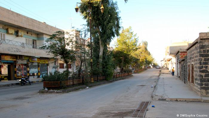 A deserted, rundown street in Derike, Syria