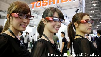 Toshiba Corp. employees wear Toshiba Glass, a glasses-type display that allows wearers to see information and images posted on the Internet without their view being blocked, at CEATEC Japan 2014, one of the largest electronics and information technology trade fairs in Asia, at the Makuhari Messe convention center in Chiba, east of Tokyo, October 7, 2014