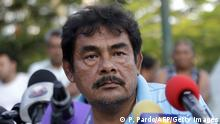 Teacher Felipe de la Cruz speaks during a press conference offered along relatives of the 43 missing students at Ayotzinapa school in Tixtla, Guerrero state, Mexico, on November 7, 2014. Suspected gang members in Mexico confessed to killing more than 40 missing students and incinerating their remains in a grisly case that shocked the country and triggered angry protests, authorities said Friday. Facing the biggest crisis of his administration, President Enrique Pena Nieto vowed to hunt down all those responsible for the 'horrible crime.' Authorities have been searching for 43 students since gang-linked police attacked their buses in the southern city of Iguala on September 26, allegedly under orders of the mayor and his wife in violence that left six people dead. AFP PHOTO/Pedro PARDO (Photo credit should read Pedro PARDO/AFP/Getty Images)