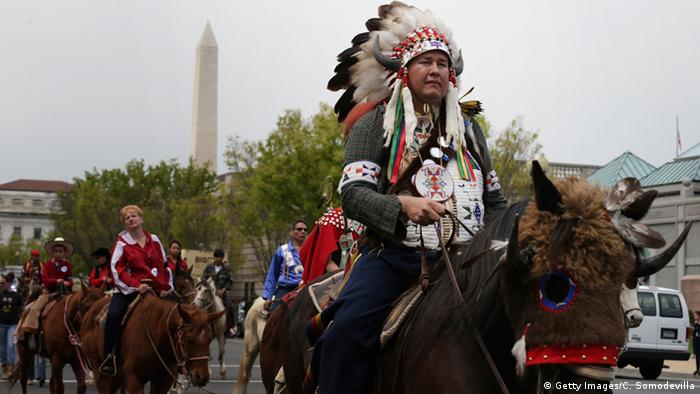A picture showing Native Americans from the Rosebud Sioux tribe leading a protests of cowboys and farmers against the Keystone XL pipeline.