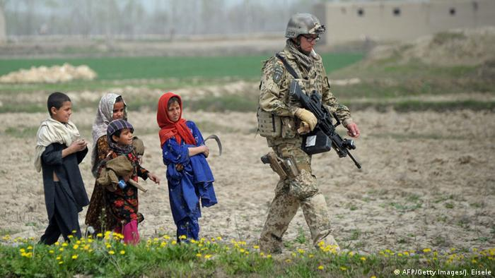 Afghan children follow a German soldier on patrol in Nahr i Sufi near the DHQ (Char Dara District Police Headquarter) in the province of Kunduz on March 30, 2012 (Photo: JOHANNES EISELE/AFP/Getty Images)