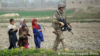 Soldier with children in Afghanistan