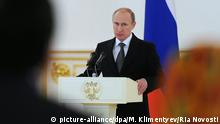 Russian President Vladimir Putin making a speech