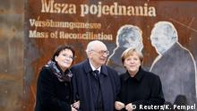 Poland's Prime Minister Ewa Kopacz, Secretary of State Wladyslaw Bartoszewski and German Chancellor Angela Merkel (L-R) pose during an official ceremony in the village of Krzyzowa November 20, 2014. The ceremony is part of the celebrations marking the 25th anniversary of a Polish-German World War II reconciliation meeting. In November 1989 Polish Prime Minister Tadeusz Mazowiecki and German Chancellor Helmut Kohl took part in a holy mass in Krzyzowa, starting the first World War II reconciliation effort between democratic Poland and united Germany. REUTERS/Kacper Pempel (POLAND - Tags: POLITICS ANNIVERSARY)