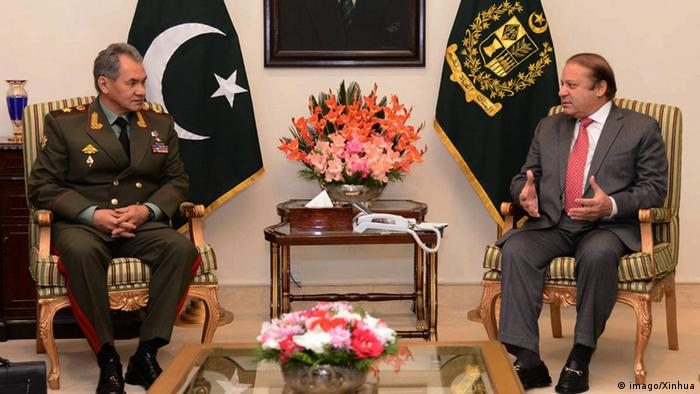 Pakistani Prime Minister Nawaz Sharif (R) meeting with Russian Defense Minister Sergei Shoigu at the Prime Minister House in Islamabad, capital of Pakistan