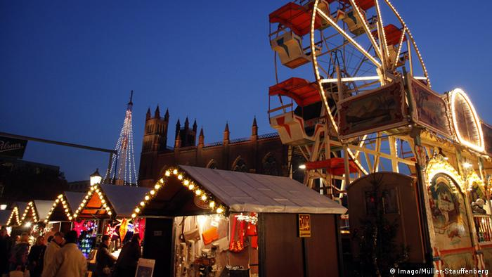 Nostalgic Christmas market at Schlossplatz, in Berlin with its old-style booths.