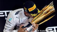 Mercedes Formula One driver Lewis Hamilton of Britain celebrates on the podium after winning the Abu Dhabi F1 Grand Prix at the Yas Marina circuit in Abu Dhabi November 23, 2014. REUTERS/Ahmed Jadallah (UNITED ARAB EMIRATES - Tags: SPORT MOTORSPORT F1)