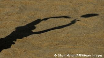 Shadow of someone playing volleyball (Shah Maraii/AFP/Getty Images)