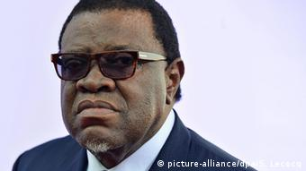 Namibian President Hage Geingob, wearing a suit and sunglasses.