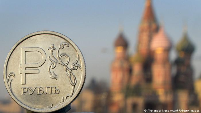 A ruble pictured with Moscow in the background