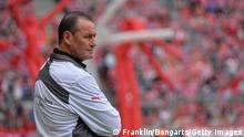 MUNICH, GERMANY - MAY 10: Huub Stevens, head coach of Stuttgart ponders during the Bundesliga match between Bayern Muenchen and VfB Stuttgart at Allianz Arena on May 10, 2014 in Munich, Germany. (Photo by Stuart Franklin/Bongarts/Getty Images)