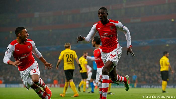 Arsenal players celebrate Sanogo's goal