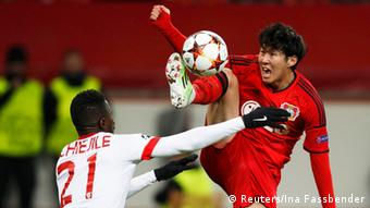 Leverkusen player contests for ball
