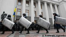 Members of the National Guard of Ukraine gather outside the parliament building in Kiev November 27, 2014. The first session of a new Ukrainian parliament, elected in October, will take place on Nov. 27, news agency Interfax Ukraine quoted the head of a parliamentary working group, Volodymyr Groysman, as saying on November 19. REUTERS/Valentyn Ogirenko (UKRAINE - Tags: POLITICS)
