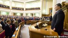 Ukraine's President Petro Poroshenko (R, front) and Parliament Speaker Oleksander Turchinov (R, back) attend a session of the parliament in Kiev, November 27, 2014. The first session of a new Ukrainian parliament, elected in October, will take place on Nov. 27, news agency Interfax Ukraine quoted the head of a parliamentary working group, Volodymyr Groysman, saying on November 19. REUTERS/Anastasia Sirotkina/Pool (UKRAINE - Tags: POLITICS)