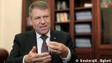 Romania's incoming President Klaus Iohannis gestures during an interview with Reuters at his campaign office in Bucharest November 25, 2014. Parliamentary support for Romanian Prime Minister Victor Ponta's government could melt away within weeks and lead to his ouster next year, Iohannis told Reuters on Tuesday. REUTERS/Radu Sigheti (ROMANIA - Tags: POLITICS)